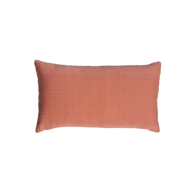 This lumbar throw pillow has been ethically hand woven by artisans in Nagaland, India, using a traditional weaving...