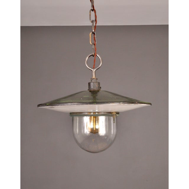A highly visual saucer form Swiss street lamp designed and manufactured by BAG TURGI, Switzerland. The upper half has a...