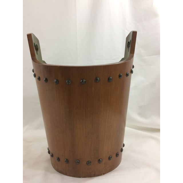 This trashcan is much too cute for trash--apparently the previous owner thought so as well! This teak piece has stud...