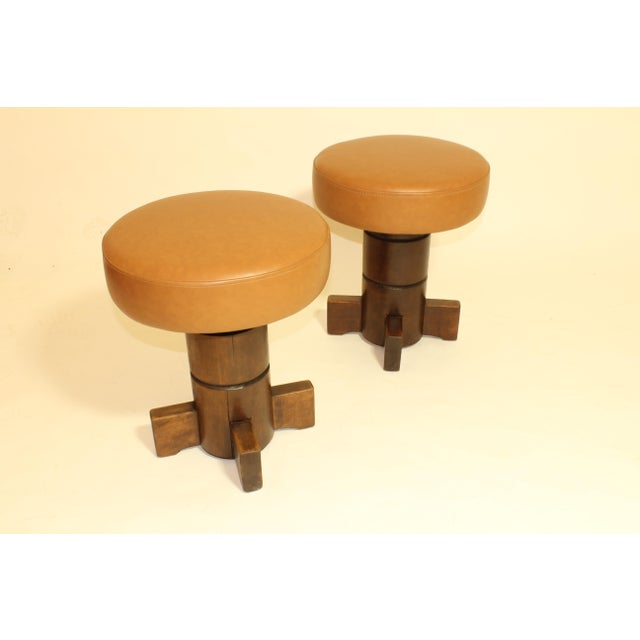 Nautical themed mahogany stools with leather seats. Designed in the 1960s and newly upholstered. Original finish.