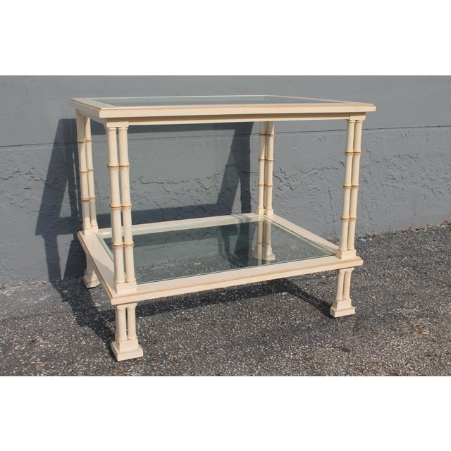 A vintage triple stalked faux bamboo accent/ side table in faux white. Made in the 1960s.
