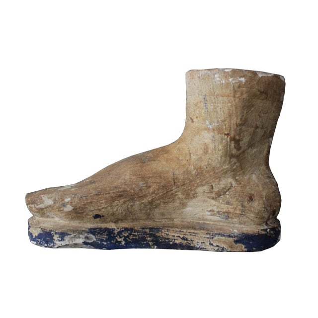 This unique piece is definitely an attention getter. This unusual oversized piece in the form of a Roman foot is probably...
