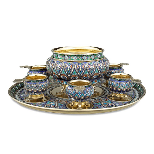 This rare Russian enamel vodka and punch bowl set is a tour-de-force of Czarist-period craftsmanship. Comprising six...