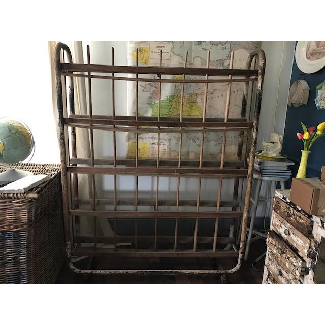 Offering a charming European industrial bakery rack for breads. Original condition, writing still visible on one rack....