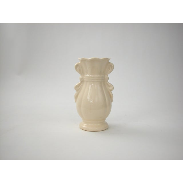 Vintage USA Pottery vase with ruffled edge and ribbon handles. No chips or cracks, aged crazing throughout.