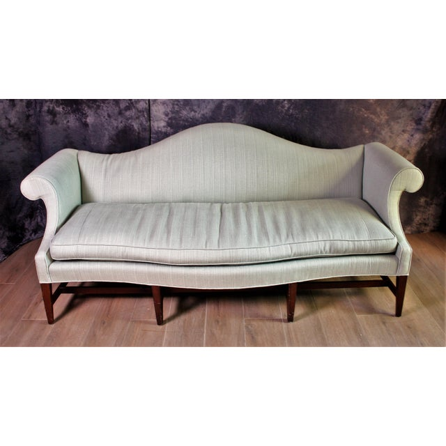 Antique Federal Style Sofa with a camel-back and serpentine bow front edge. Features luxury Claydon Old Blue 100% Belgian...