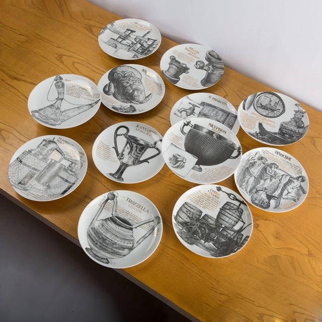 Stunning set of 12 dinner plates by Piero Fornasetti for Martini & Rossi. The set was commissioned by Martini Rossi with...
