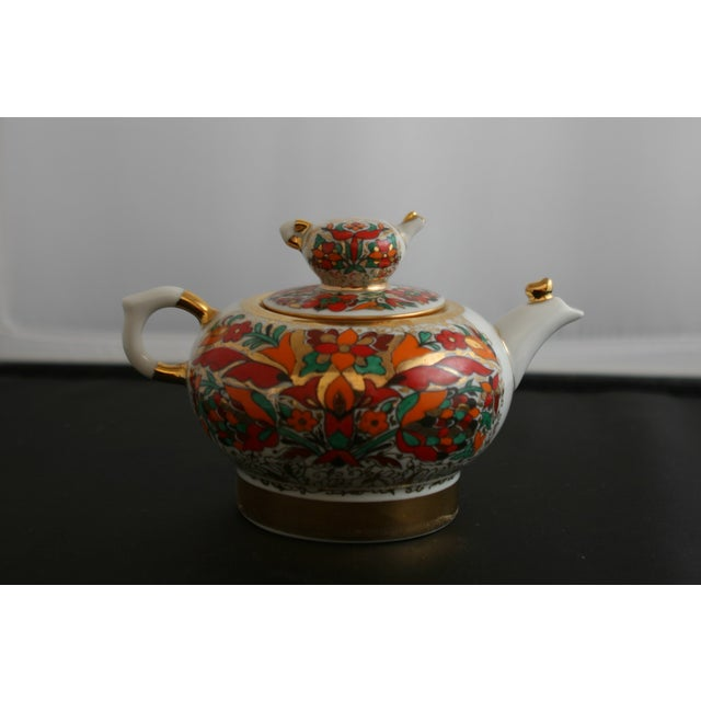 Small Russian Imperial Lomonsov porcelain teapot with a white background and hand painted detail by Russian artists at the...