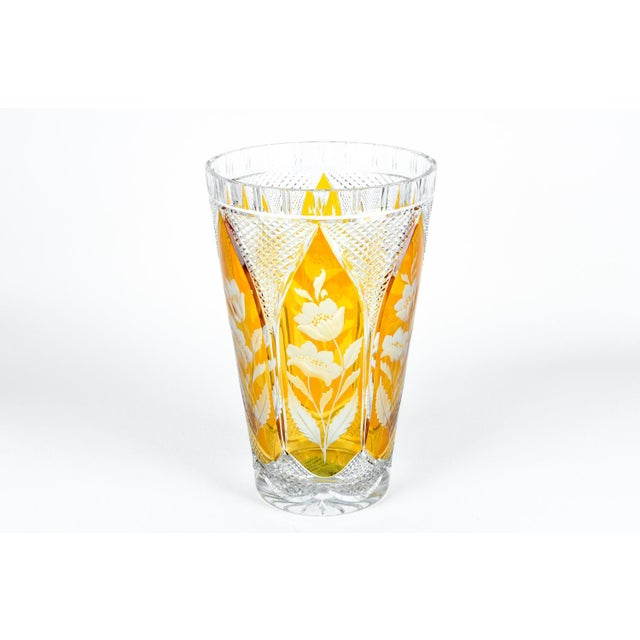 Vintage crystal vase cut with floral design in amber and clear.