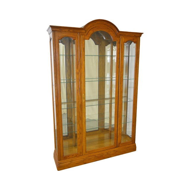 Jasper Traditional Oak Beveled Glass Lighted Curio Display Cabinet - Image 1 of 9