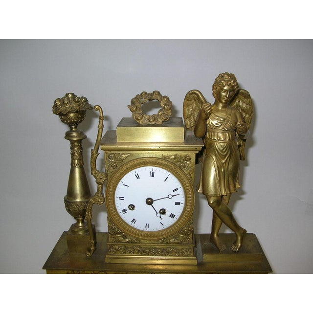 Up for sale is a French Charles X gilt bronze dore figural mantel clock, early 19th century, the figure of Amore resting...