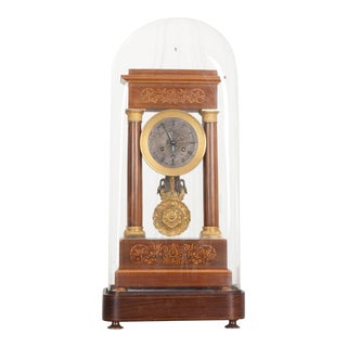 French 19th Century Empire Marquetry-Inlaid Satinwood and Gilt-Bronze Portico Clock For Sale