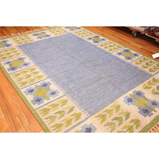 Vintage Kilim by Berit Woelfer, Sweden, Mid 20th Century — Simple in its color scheme and overall presentation, this...