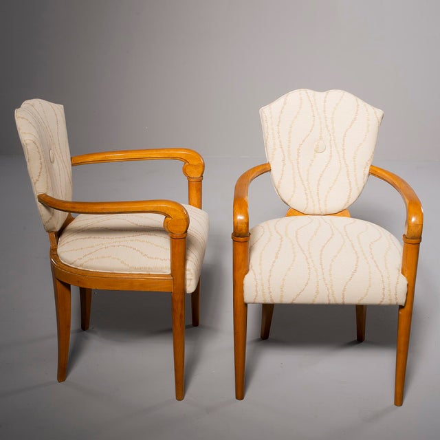 Pair circa 1940s French bridge chairs have polished beech frames with curved arms, shield-shaped back rests and are newly...
