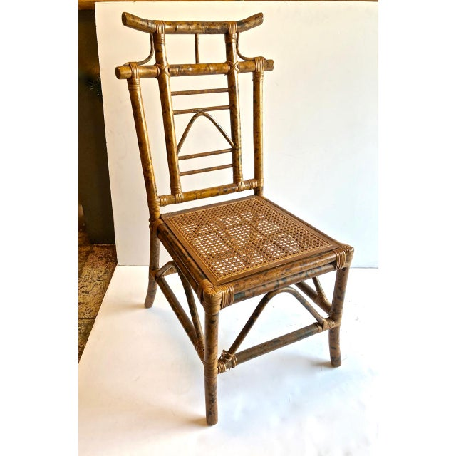 This is a highly decorative set of 4 pagoda-backed side chairs. The chairs are crafted in flamed bamboo and date to the...