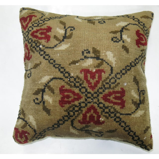 Pillow made from a vintage karabagh rug with cotton back. Zipper closure and foam insert provided. 19'' x 19''