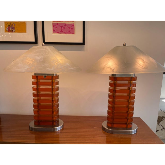 Stunning pair of mid-century acrylic and glass shaded lamps. These are very unique to find as a pair and in mint...