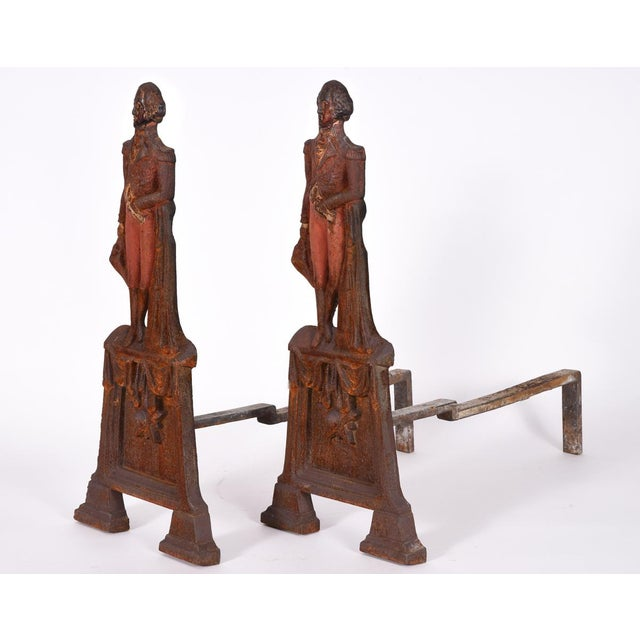 Pair of mid-20th century George Washington andirons with removable firedogs. The pair is in excellent vintage condition....