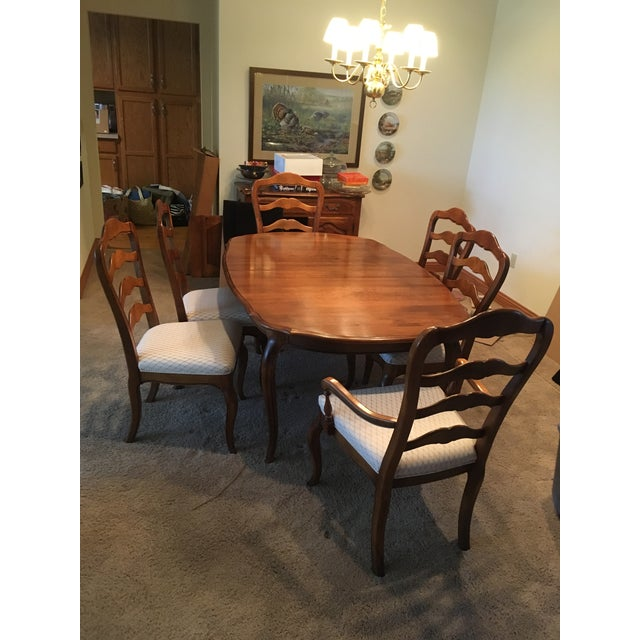 Ethan Allen French Country dining table and chair set. Built in the 1990's and well kept with covers for the table and two...