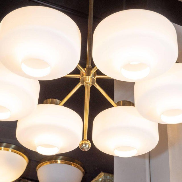 This stunning and graphic chandelier was realized in Sweden, circa 1960. It features six lustrous brass arms emanating...