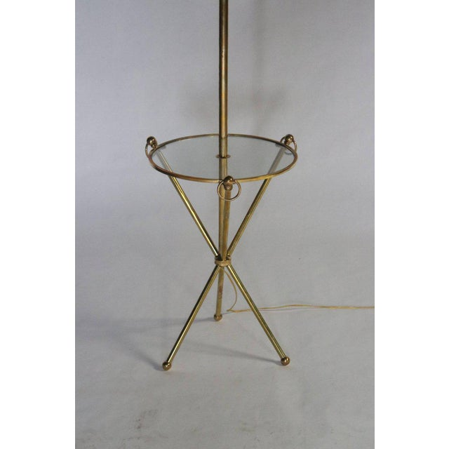 Midcentury brass and glass tripod floor lamp with loops handles, glass table and brass ball feet. Topped with a new custom...