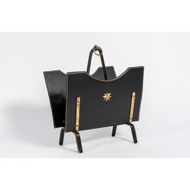 Perfect condition magazine rack by Jacques Adnet.