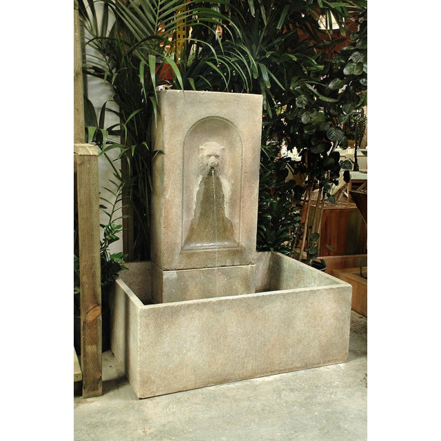 Our Lion Fountain consists of a lion's head spitter on a tall rectangular faux stone backdrop. The top piece has a...
