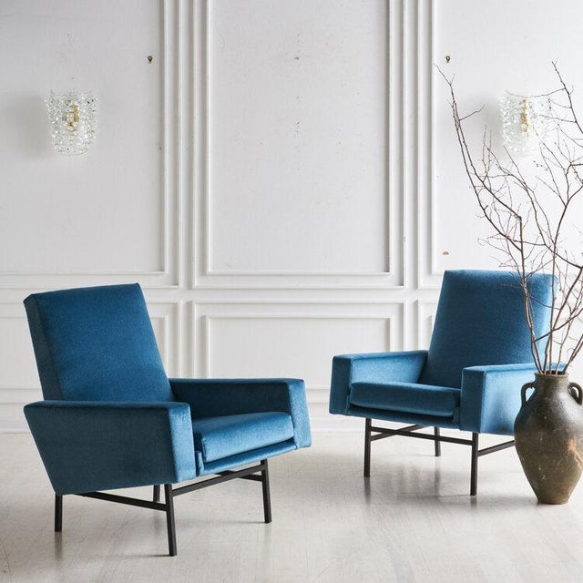 A pair of clean lined lounge chairs designed by ARP, a group of three Frenchdesigners Gariche, Motte and Mortier for...