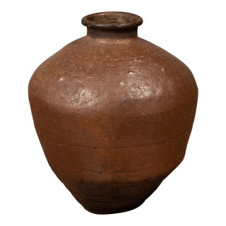 Antique Japanese Brown Oil Jar with Weathered Appearance and Irregular Shape For Sale