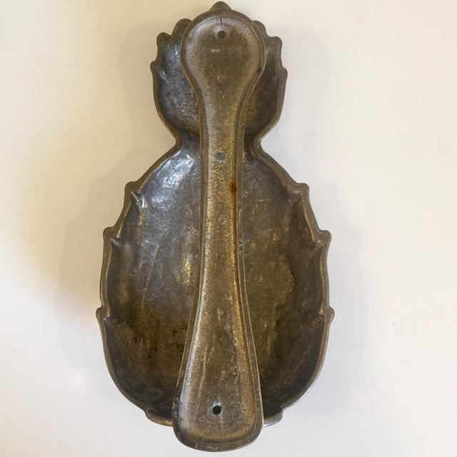Brass pineapple door knocker. Patina and tarnishing consistent with age and detailed in pictures.