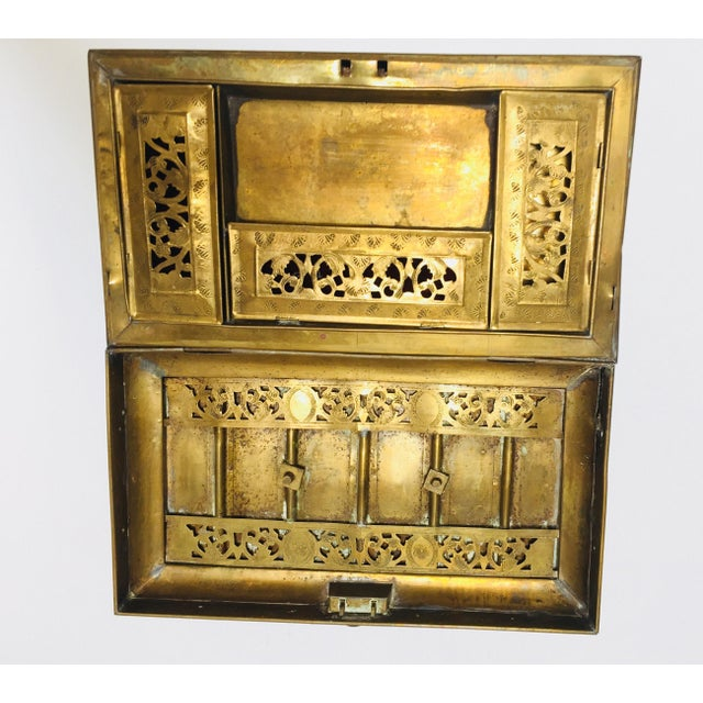 19th century Anglo Indian antique desk box handcrafted with hinged lid with a swing bail, that opens to an interior with a...
