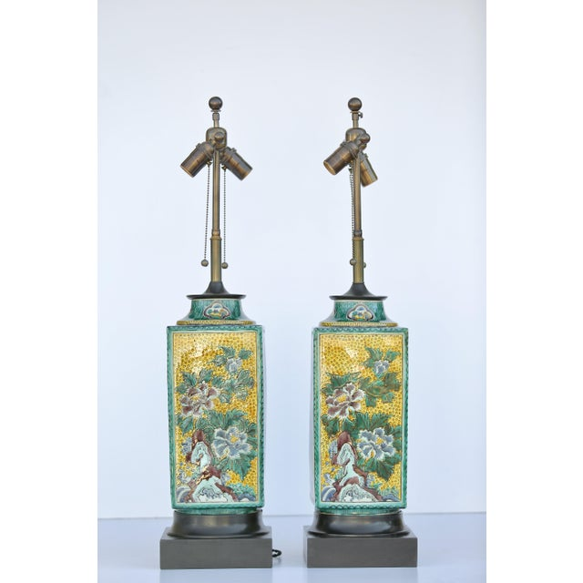 Lovely, hand painted decorative lamp by William Haines. This pair has a unique imagery on either side and looks exquisite...