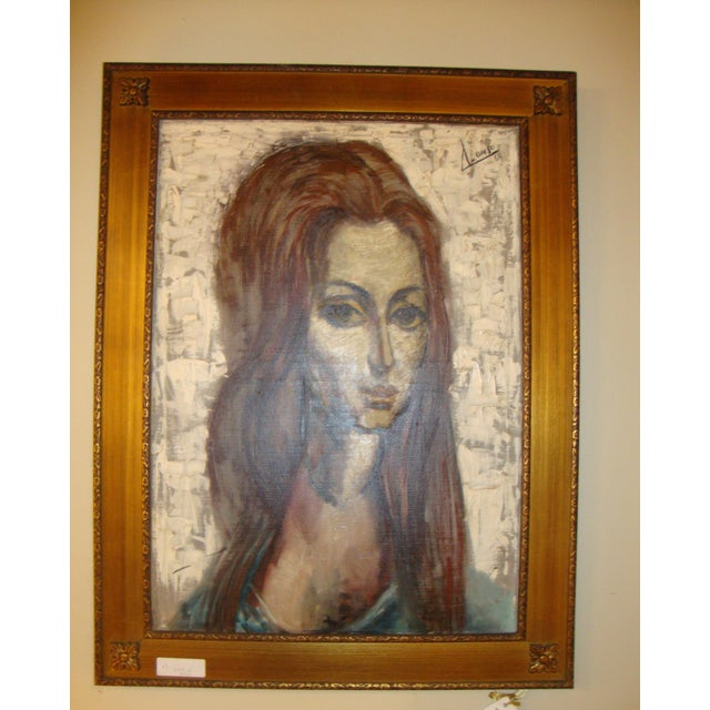 A signed oil on canvas painting of a young lady with flowing hair. Signed and dated 1964 this is a finely detailed piece...