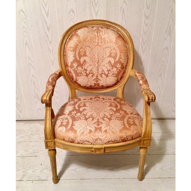 The chair is upholstered in a beautiful floral pattern. It has a very strong and high quality frame and is very...