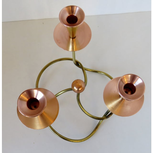 Vintage German handmade candelabra for three regular tapers, finished in brass and copper plate. Light age wear.