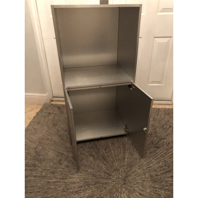 All silver front, back and inside on small wheel casters. Excellent as a bar, bathroom cart, for the office. Sleek silver...