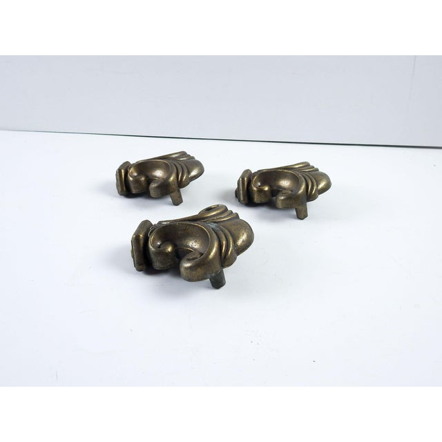 "Set of 3 hefty bronze colored metal drawer pulls. 2"" hole spacing. One small spot of oxidation."