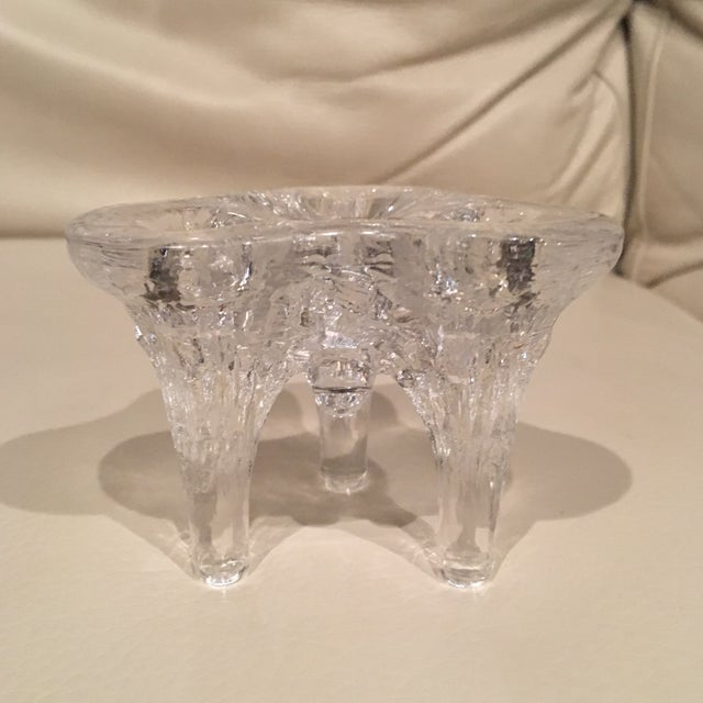 Lovely handblown glass taper candle holder. Made by the talented artists at Kosta Boda. Holds 3 tapered candles.