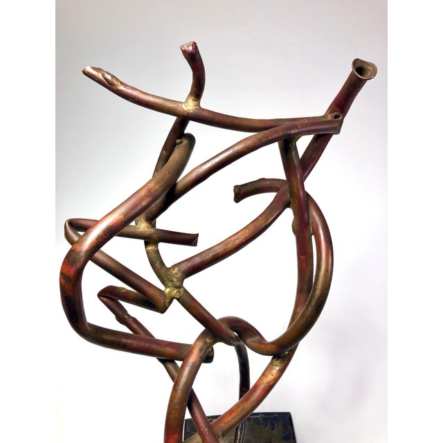 Mid-century modernist sculpture created with braised/welded copper tubular elements. The base appears to be hammered...