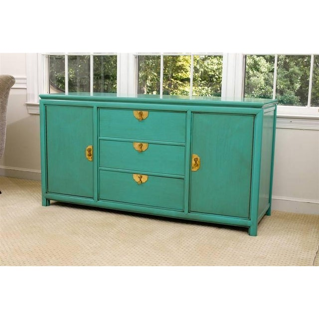 A Stunning multi-purpose case piece by Thomasville, circa 1960's. A center bank of three drawers, flanked by two open...