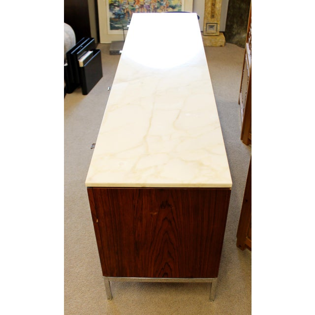 For your consideration is a ravishing, rosewood credenza, with a white marble top, and ten drawers with chrome pulls, by...