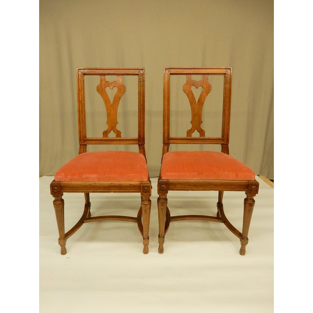 Eight 19th century French Louis XVI walnut dining chairs. They have very nice warm patina and slip in seats.