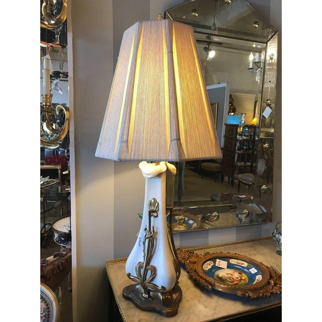 A pair of gilt brass-mounted Art Nouveau table lamps 21 inch fixture 41 inches total height. Fine white painted ceramic...