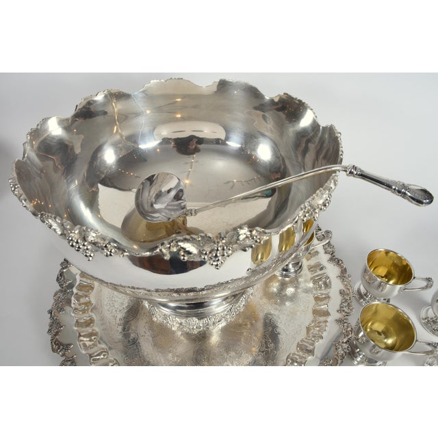 Vintage English Georgian style silver plated or copper fifteen piece punch bowl set, complete with twelve decorative cups...
