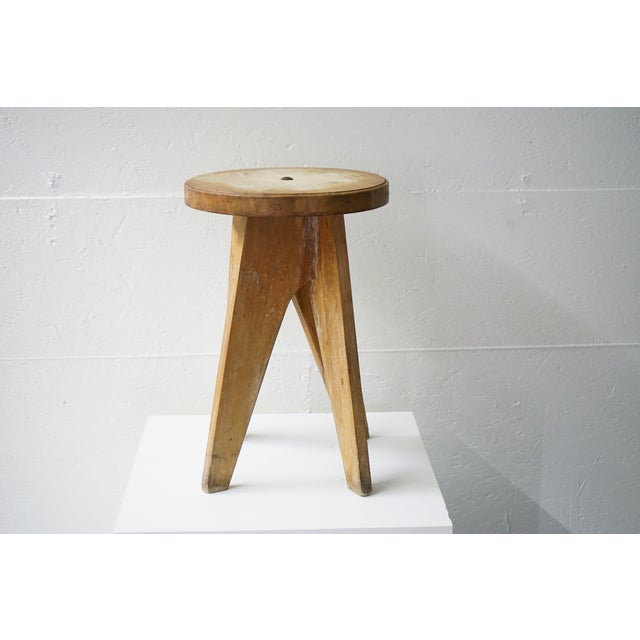 You're seeing a vintage wooden piece circa 1970's that can be used as either a stool or a table that features a flat round...