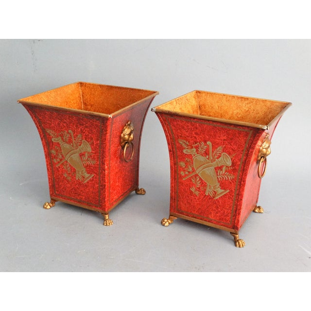 Pair of vintage metal Italian chinoiserie tole urns with 2 different scenes and lion handles. They have lovely lion paws...