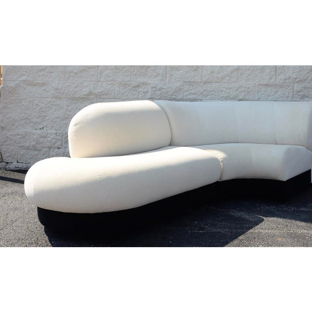 Gorgeous serpentine cream sectional with a black upholstered plinth base by preview. Extremely comfortable. Goose down...