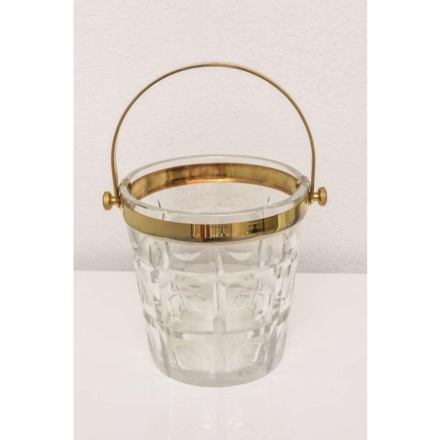 "Stunning 1940's cut crystal ice bucket with brass trim and handle. With handle up as pictured, 13.25"" high. For trade..."