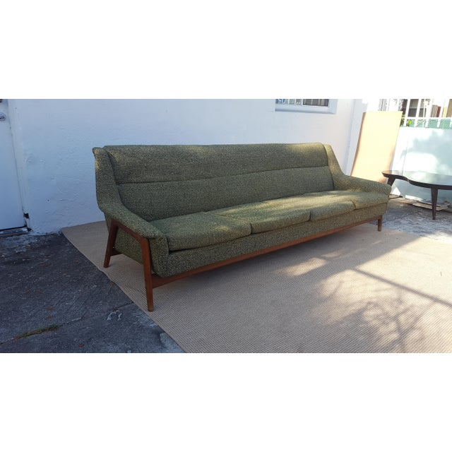 Fabulous Mid-Century Modern Four Seat Danish sofa by DUX Sweden . This piece features external splayed Teak Legs with...