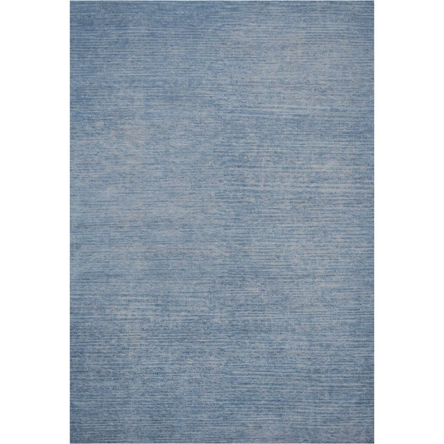 Genuine handwoven rug from Kashmir. This high quality modern rug features an amazing texture and a superb weave. Made of...
